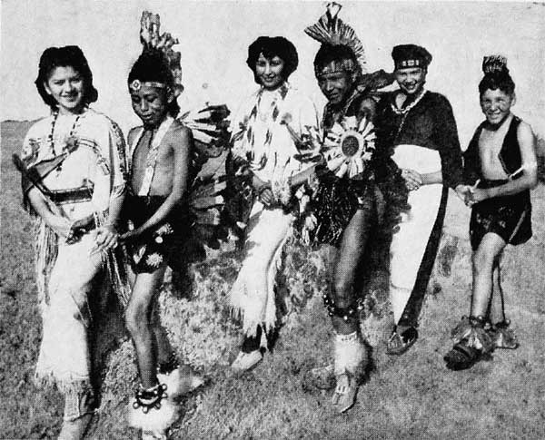 Riverside Indian 4-H Club members rehearsing for one of their dance numbers. L. to R. Beatrice Tahmalikera, Billie Tonpahhote, Lucy White Horse, Lee Monett Tsatoke, Myrtle Ann Beaver and David Joinkeen. (National 4-H News June 1943)
