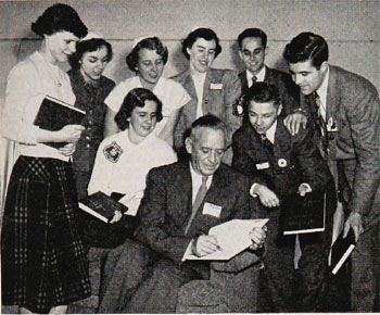 "Frank Reck, author of ""The 4-H Story"" stays busy autographing his history book for delegates at the 1951 National 4-H Congress. (From January 1952 National 4-H News)"