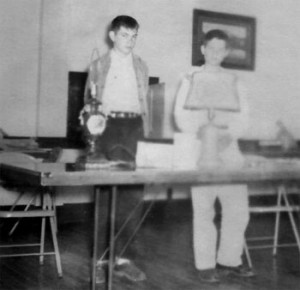 Oregon 4-H'ers in the 1950s demonstrate how to re-wire lamps at a club meeting.