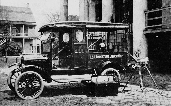 "This is one of the first-known visual education trucks. It was used in Louisiana to bring the story of club work to rural schools. The Model T engine ran a dynamo that generated current for the movie machine. This photograph appeared on page 130 of ""The 4-H Story"" by Franklin Reck."