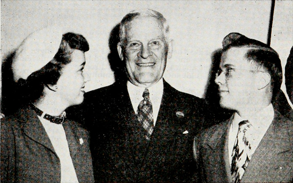 This picture really tells the story. DiAnne Mathre of Illinois and Dwight E. Nelson of Iowa, top Citizenship boy and girl at the 1949 National 4-H Congress stand with Thomas E. Wilson. The awards were made in honor of Mr. Wilson. The deep admiration of Thomas E. Wilson by the Congress delegates for four decades is reflected in the faces of these two winners.